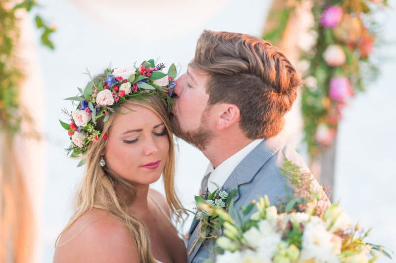 groom kiss brides forehead on wedding day