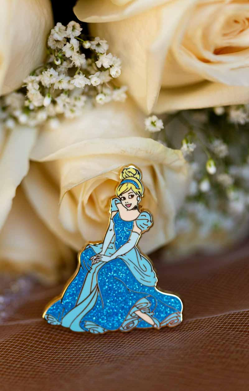 Cinderella pin in front of bridal bouquet