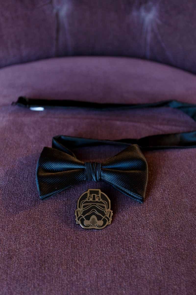 black bowtie and Darth Vader pin on purple chair