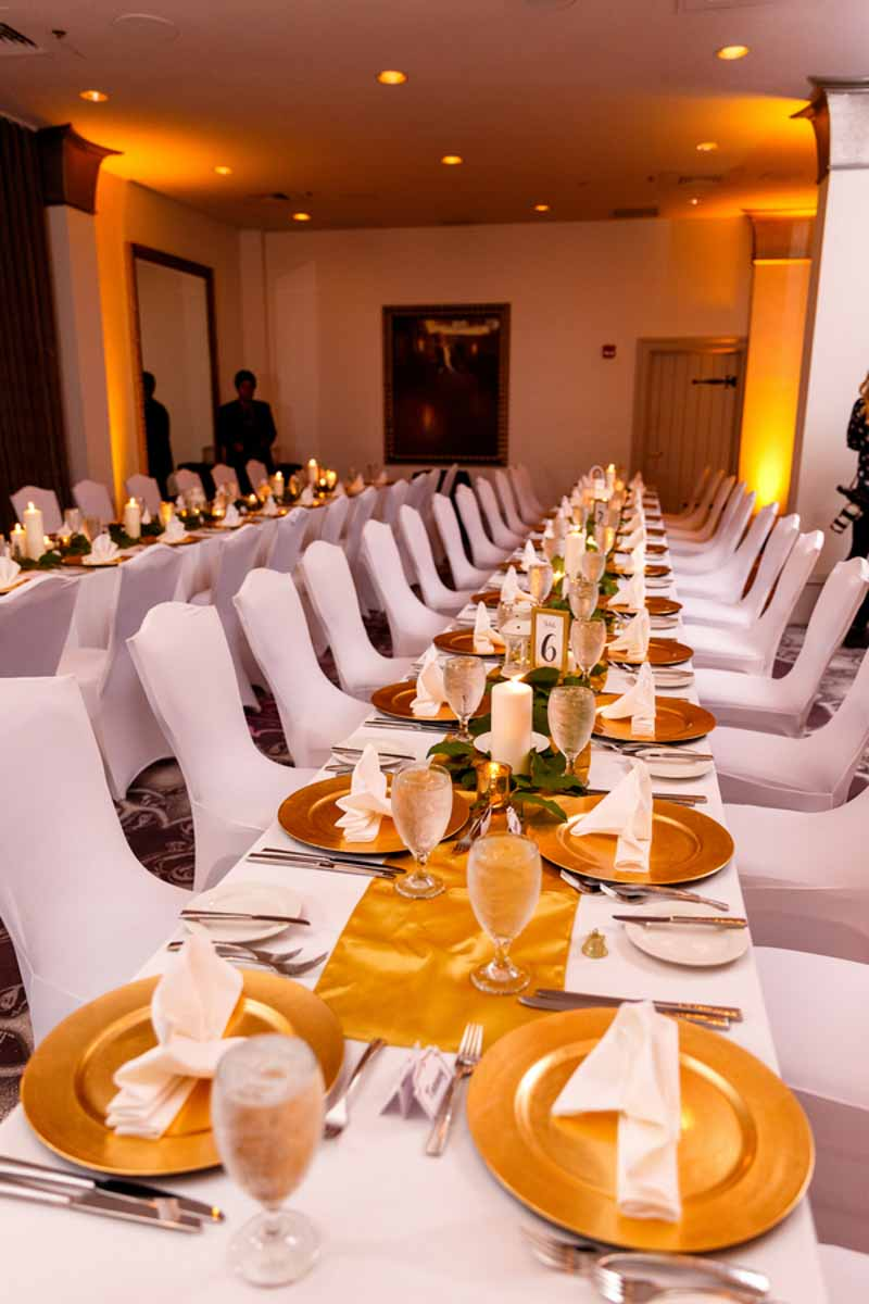 gold wedding chargers on reception table