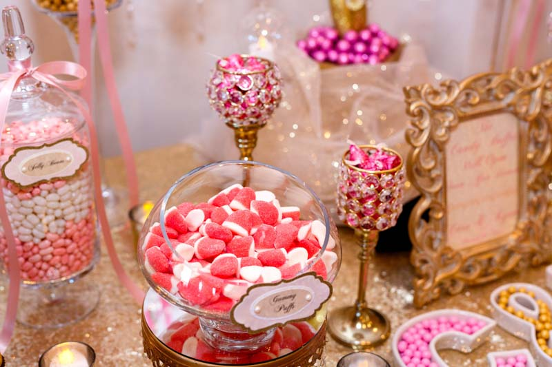 pink and white gummies on candy table