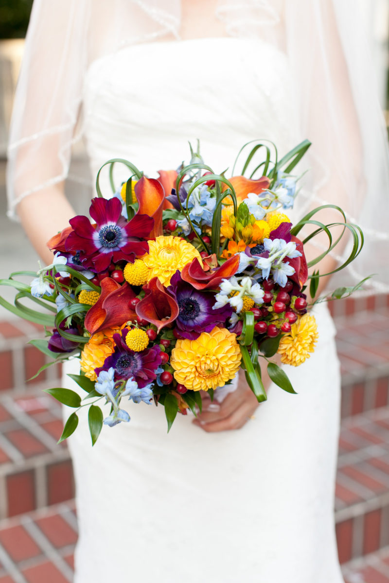 yellow mums and red anemone bridal bouquet