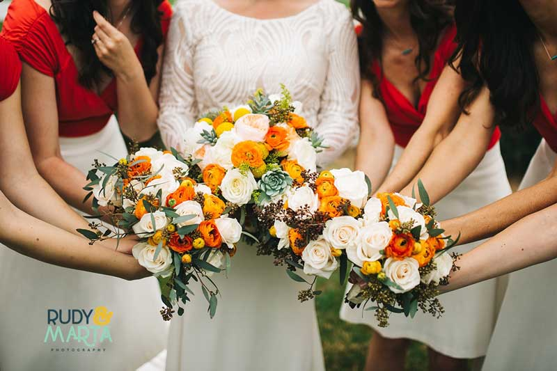 bride and bridesmaids holding fall bridal bouquets