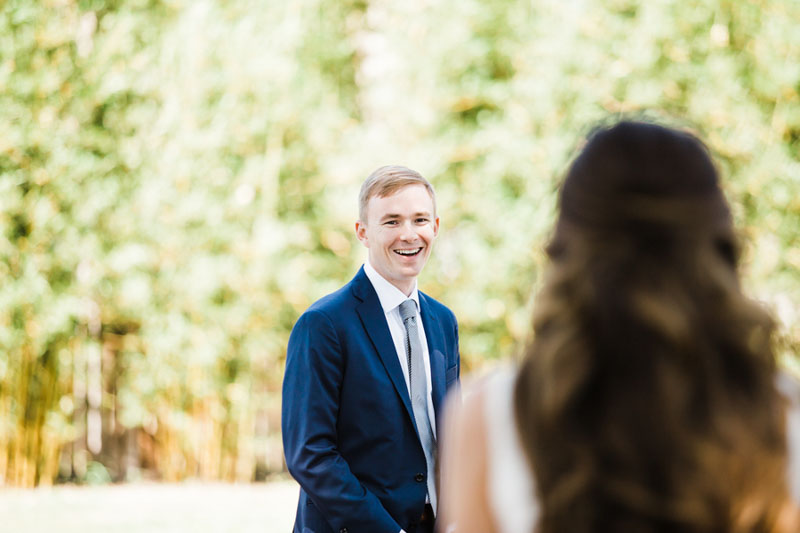 groom smiling when seeing bride for first time