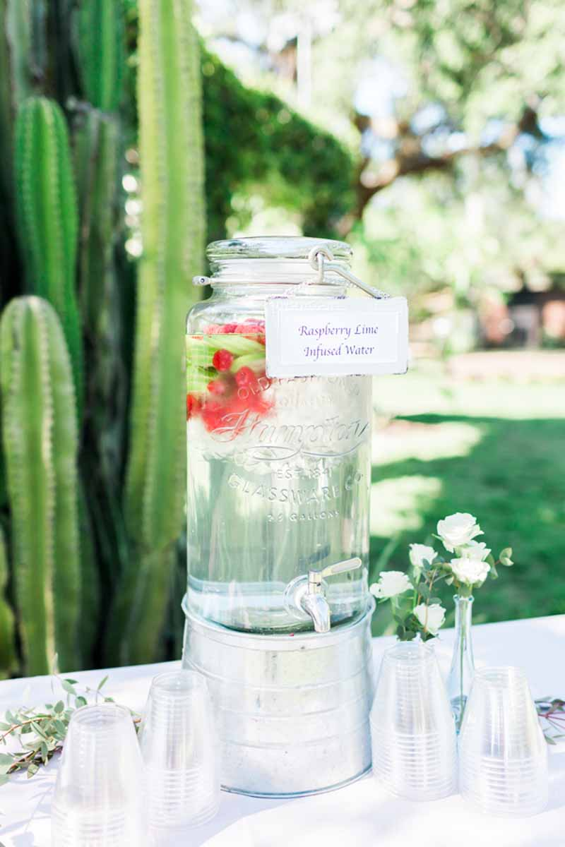 raspberry lime infused water dispenser on table