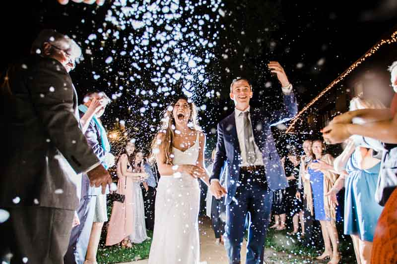 wedding guests throwing confetti for grand exit