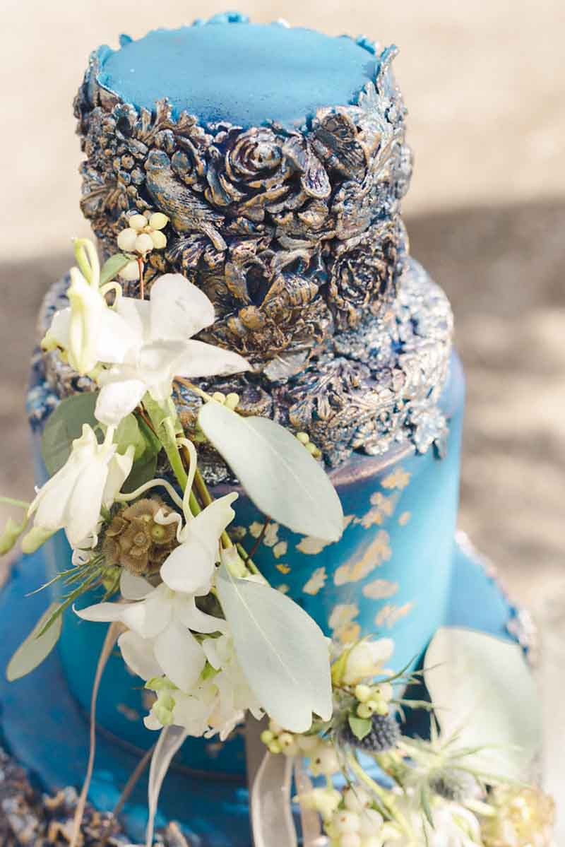 top tier of rose embossed blue wedding cake