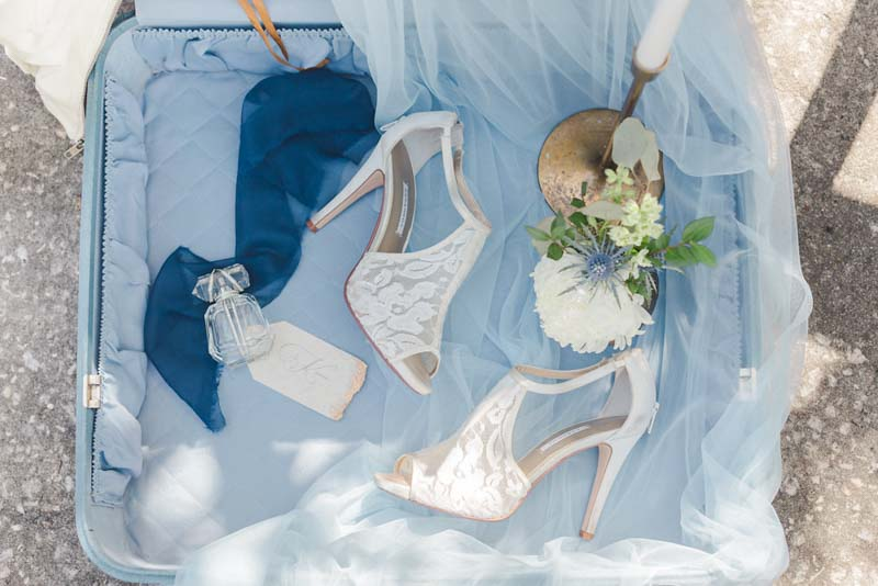 lace bridal shoes in blue suitcase