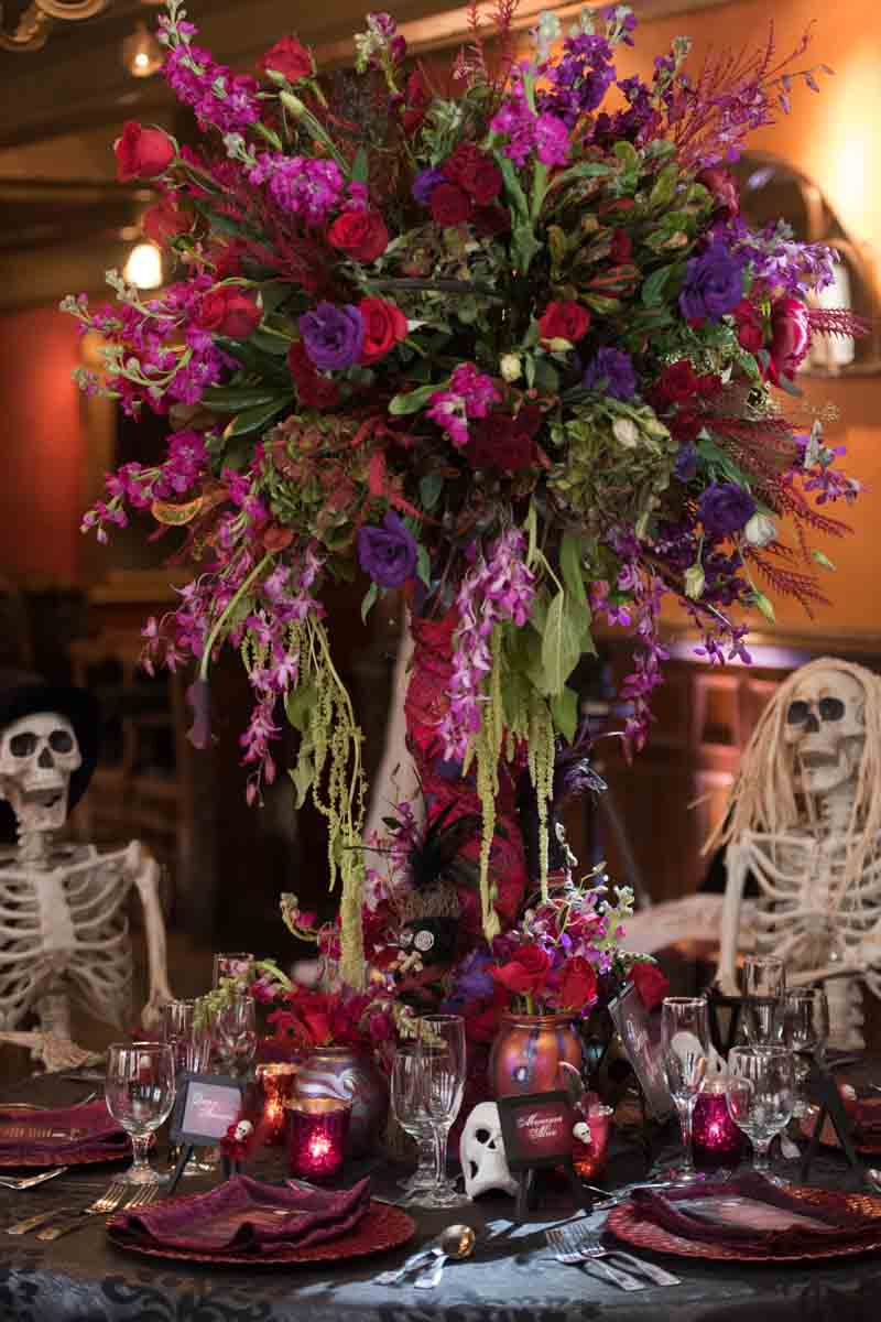 tall red and purple reception center piece