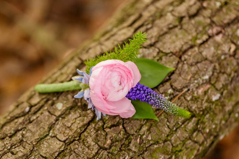pink and purple boutonniere for starry night elopement