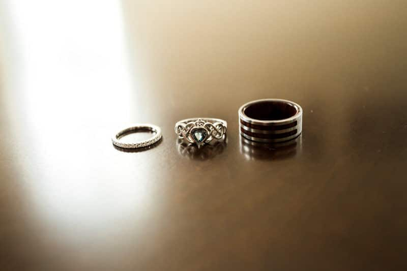 wedding bands on table