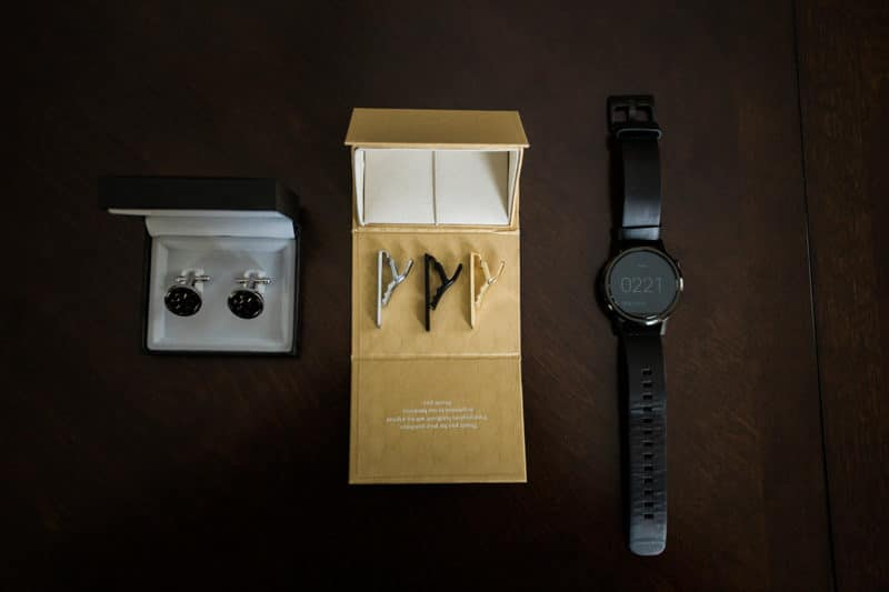 groom's wedding cuff links, tie clip, and watch