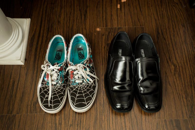 bride's spiderman tennis shoes and groom's shoes