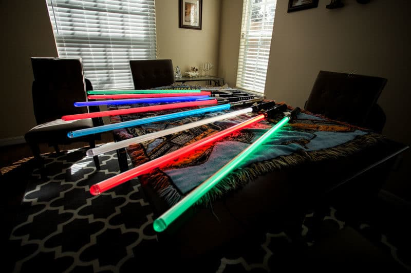 lightsabers laying on desk for Star Wars wedding