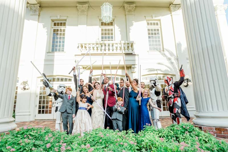 wedding party holding lightsabers in Downtown Orlando