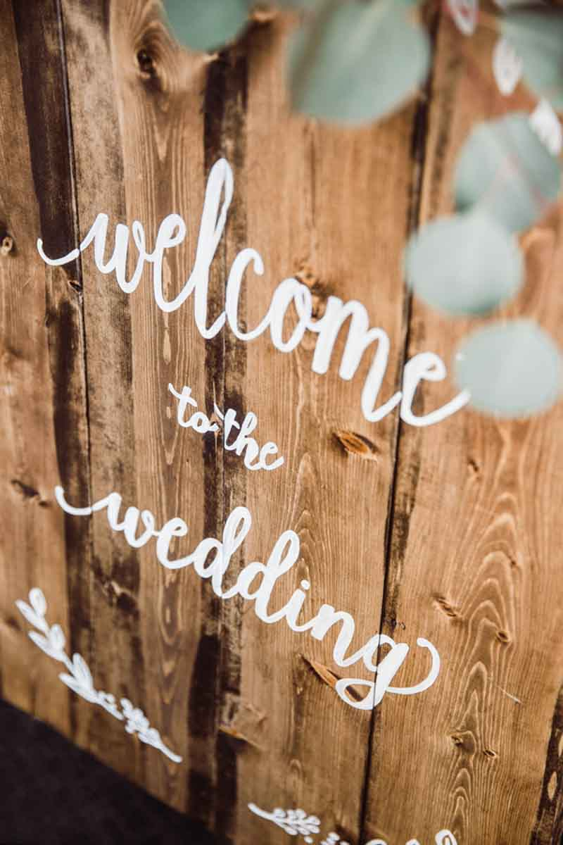 wedding welcome sign on rustic wood