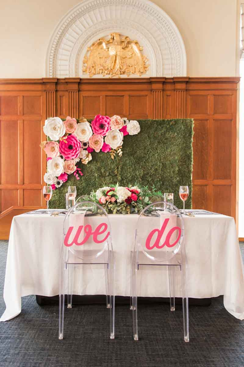 sweetheart table with ghost chairs