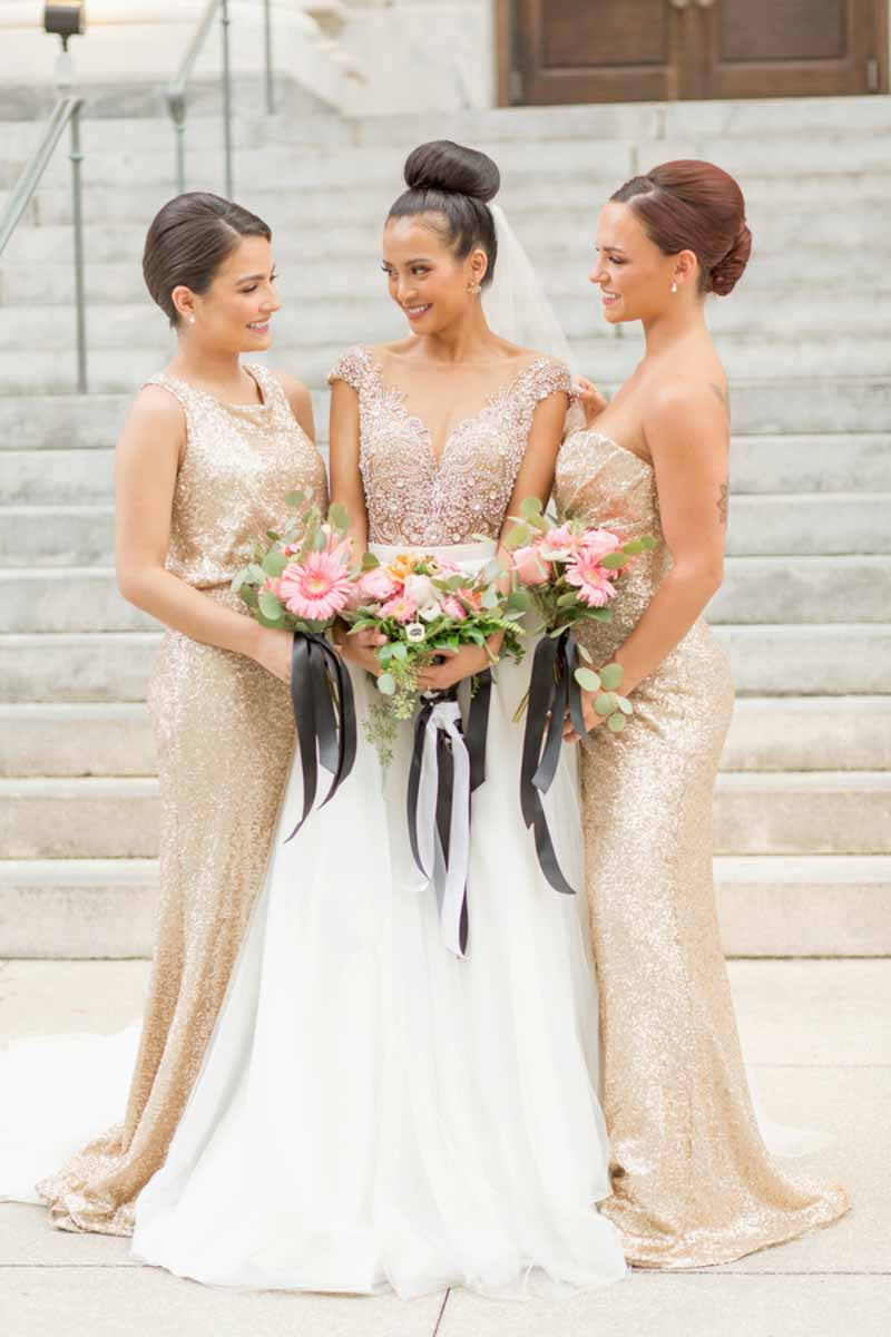 bride next to bridesmaids in gold glitter gowns