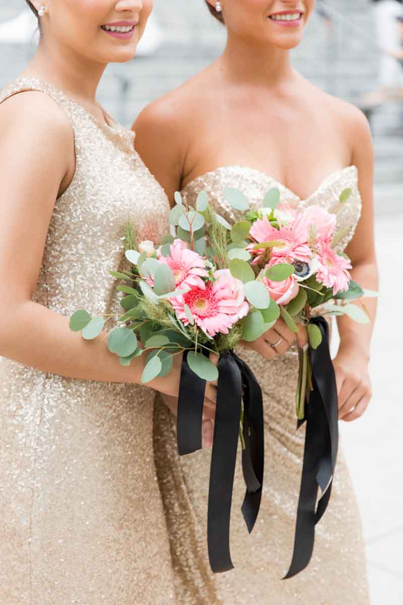 bridesmaids holding pink bouquet