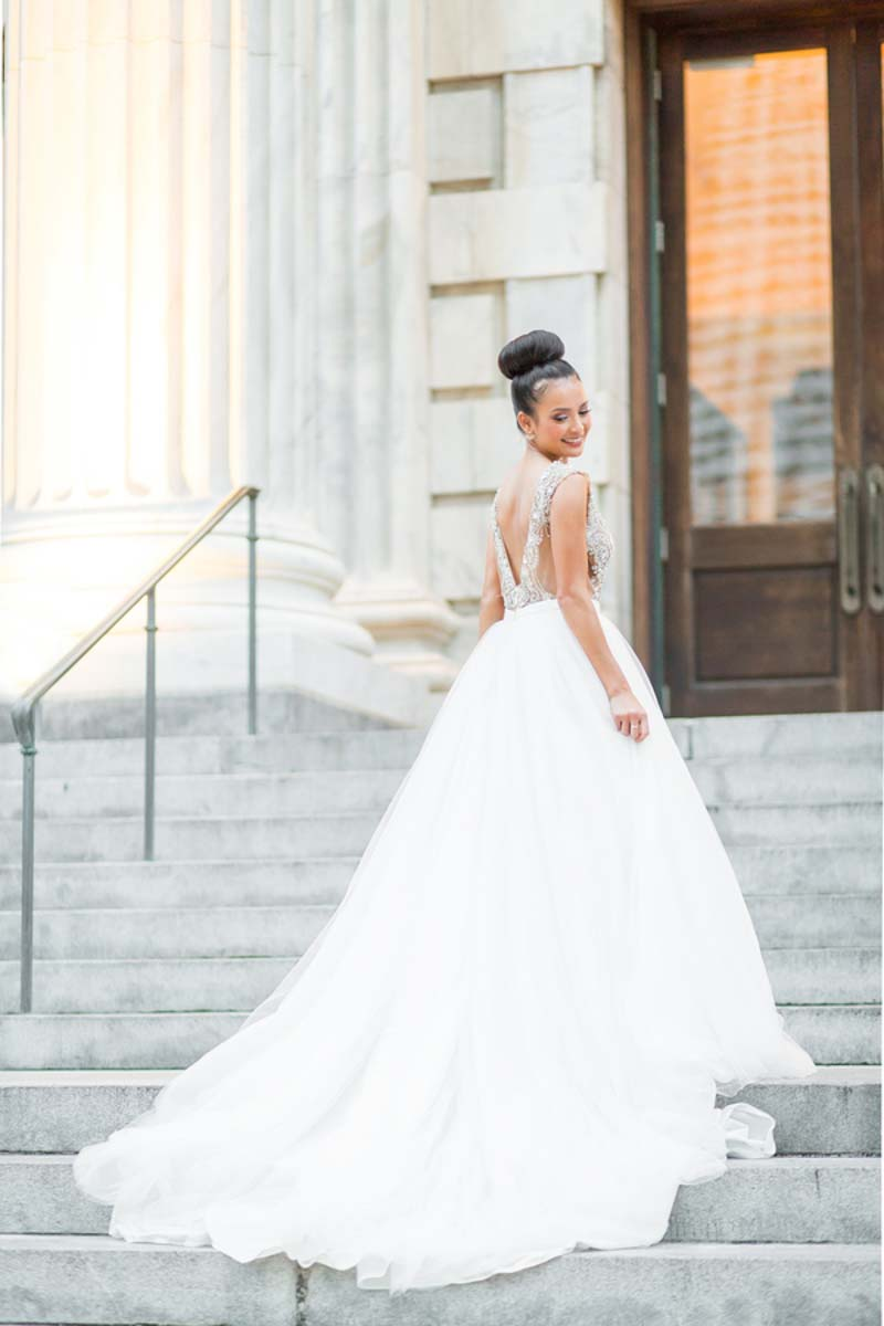 bride in ballgown on steps