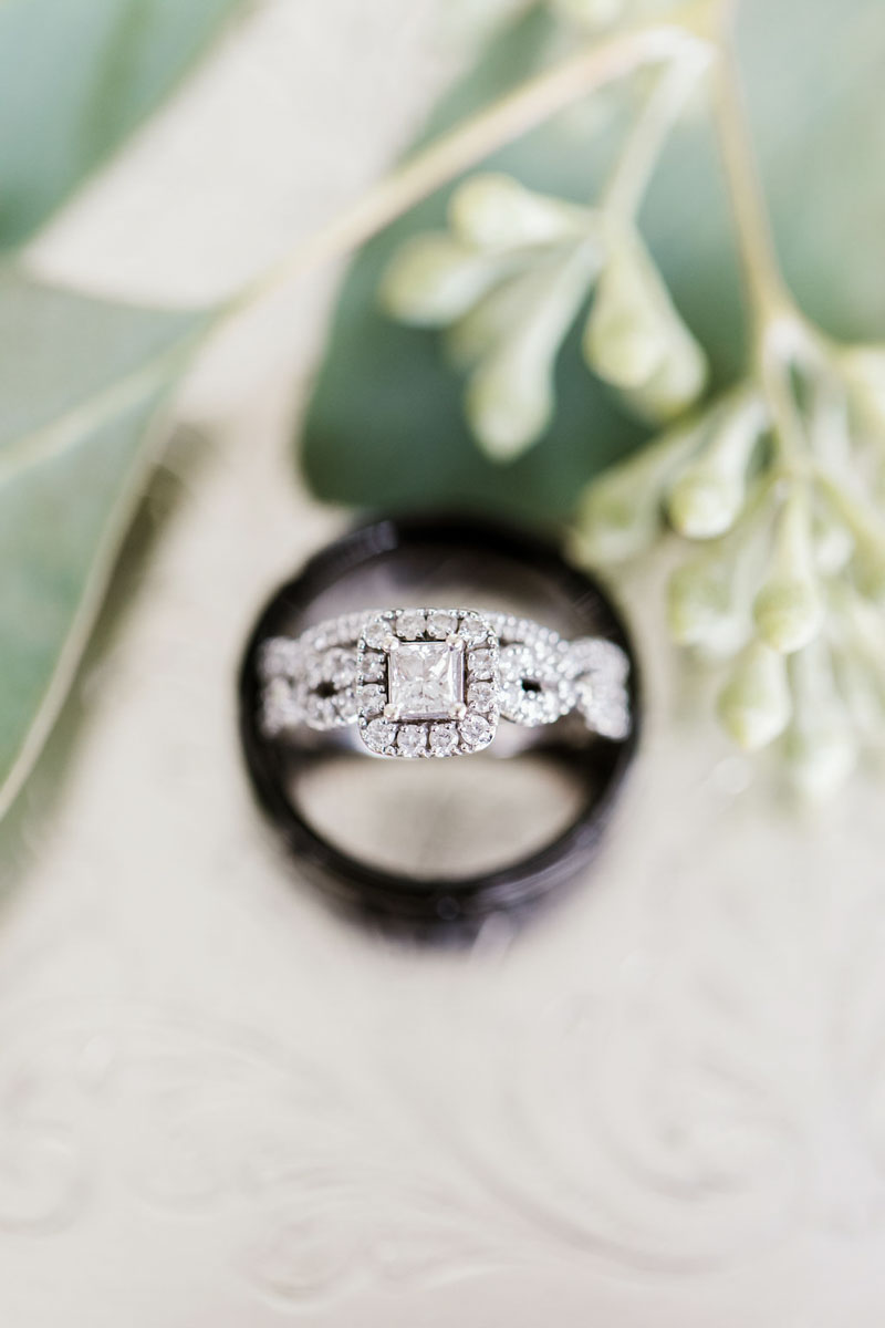 halo engagement ring inside of wedding bands