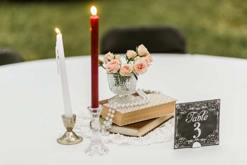 vintage books and candles for Mote-Morris House wedding centerpieces