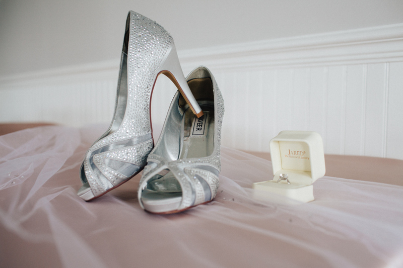 silver bridal shoes on counter