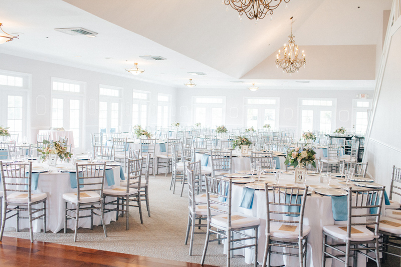 reception space at the Tuscawilla Country Club with silver chairs