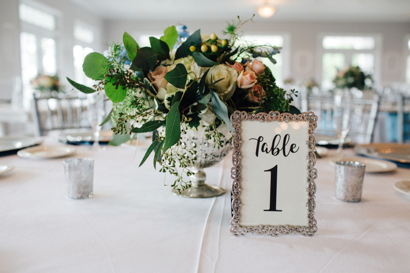 Silver framed table number on reception table