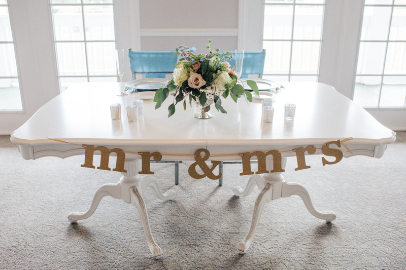 mr. and mrs. sign on sweetheart table