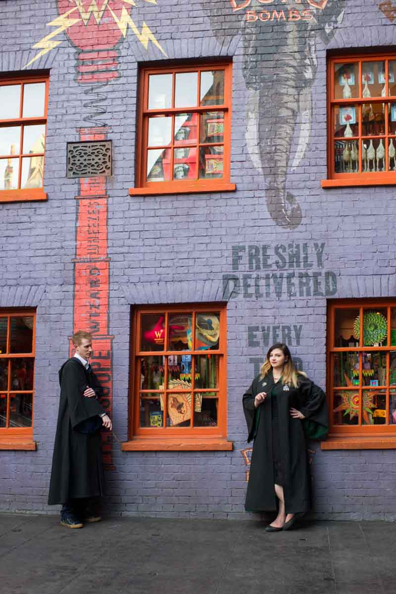 couple standing in front of Harry Potter wall mural