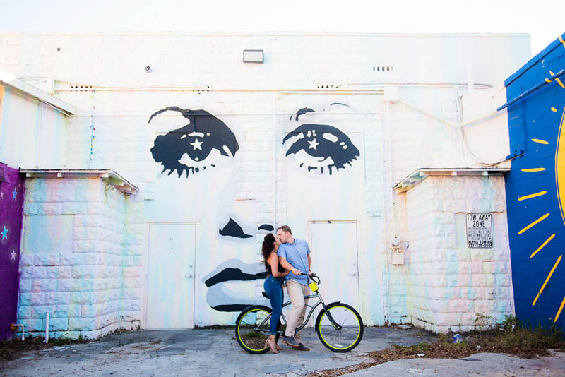 couple on bicycle in front of St. Pete wall mural
