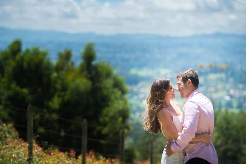 couple at engagement session on a hill
