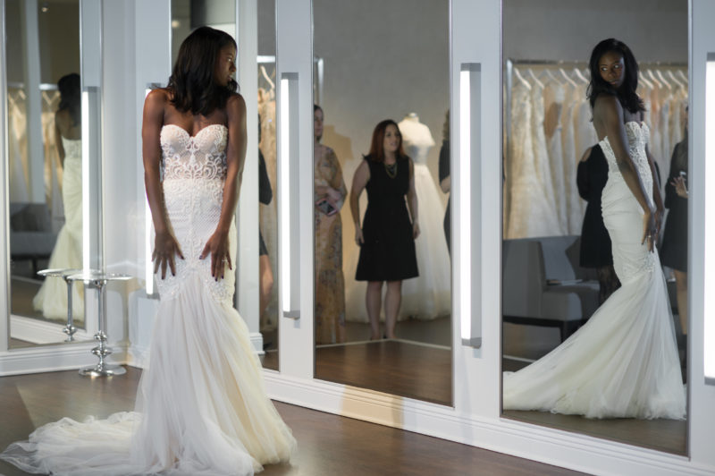 bride trying on Netta Ben Shabu gown at Solutions Bridal