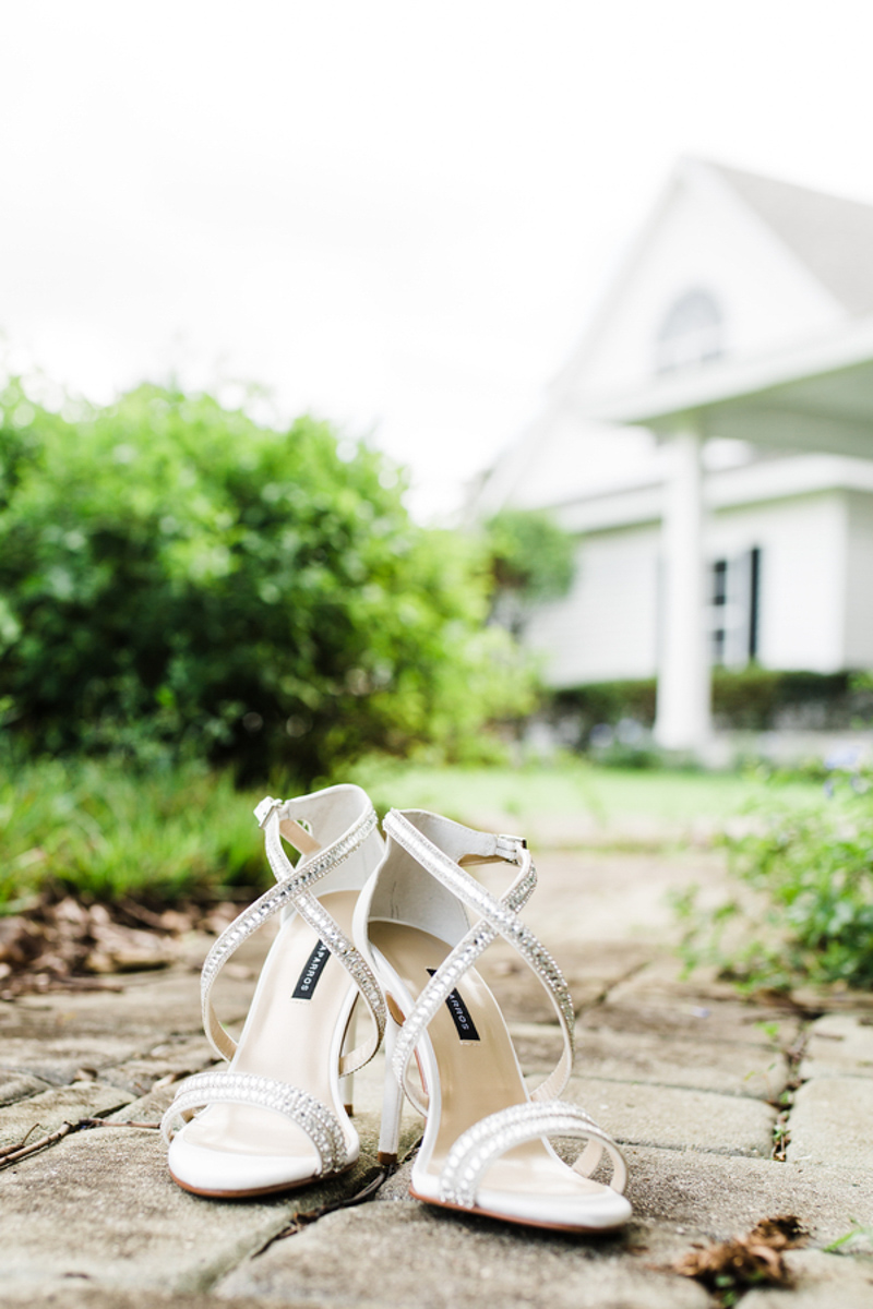 Bridal shoes on cobblestone walkway