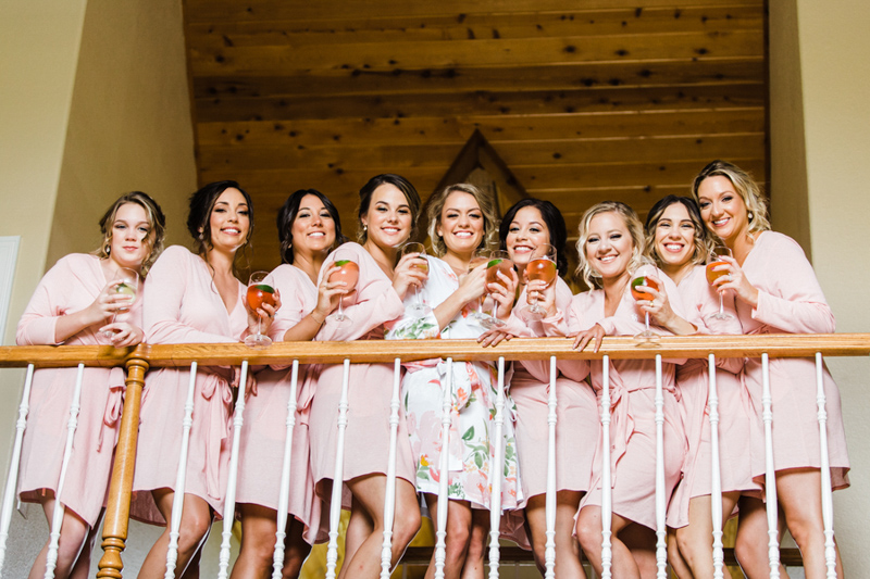 bride and bridesmaids looking over balcony