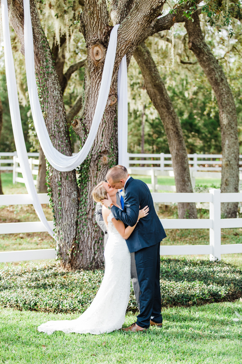 couple kissing after wedding ceremony at Bramble Tree Estate