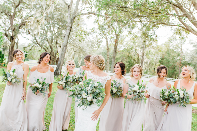 bride and bridesmaids in light mauve dresses