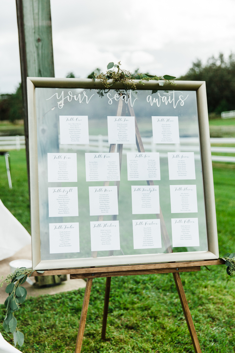 framed escort card display at Bramble Tree Estate wedding