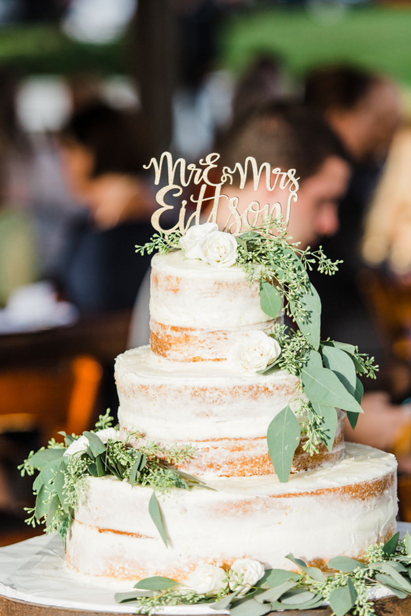 semi-naked wedding cake with greenery