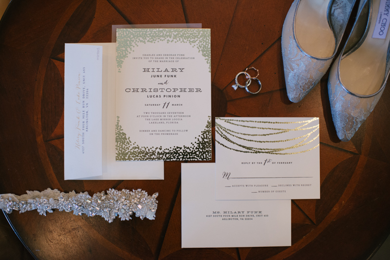 gold foil invitation suite on wood table