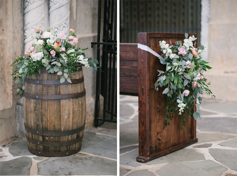 ceremony flowers on whiskey barrel and church pew