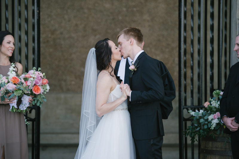 bride and grooms first kiss for wedding ceremony