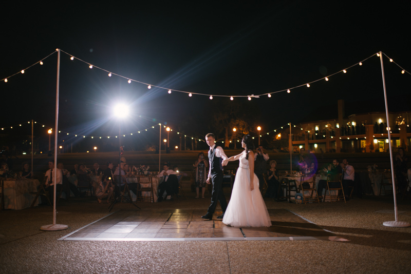 couple's first dance under market lights