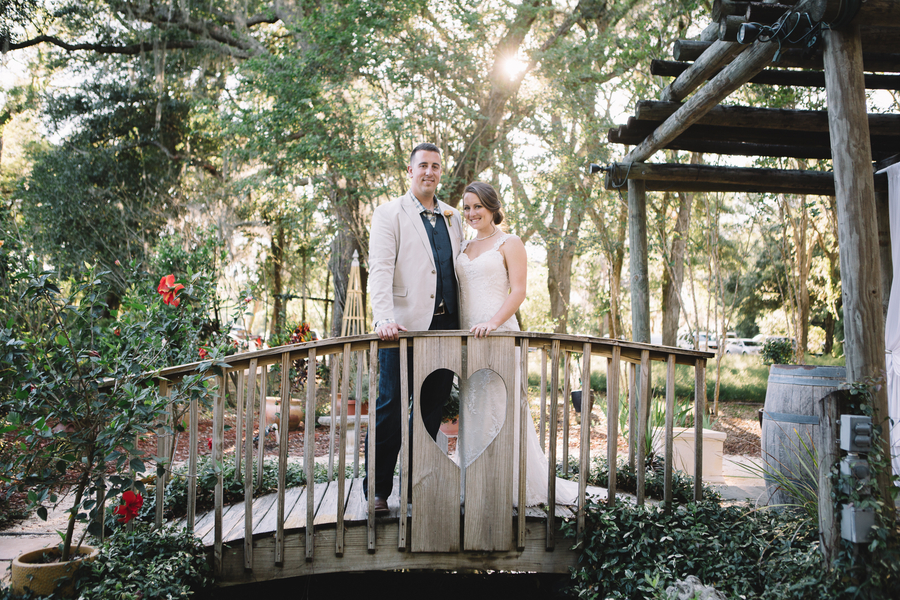 On Bridge At One Of The Central Florida Garden Wedding Venues
