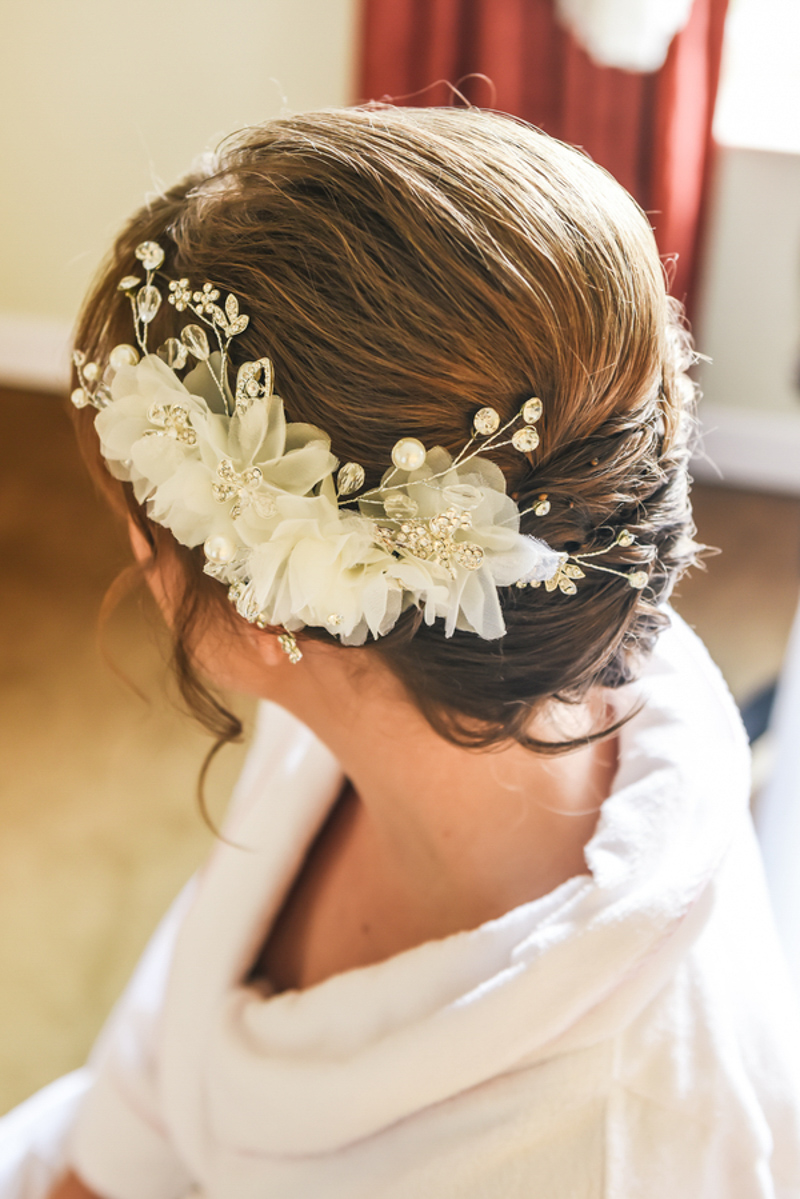 bride with floral hairpiece on her updo