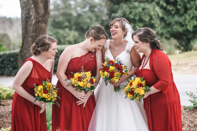 bridesmaids in red dresses laughing
