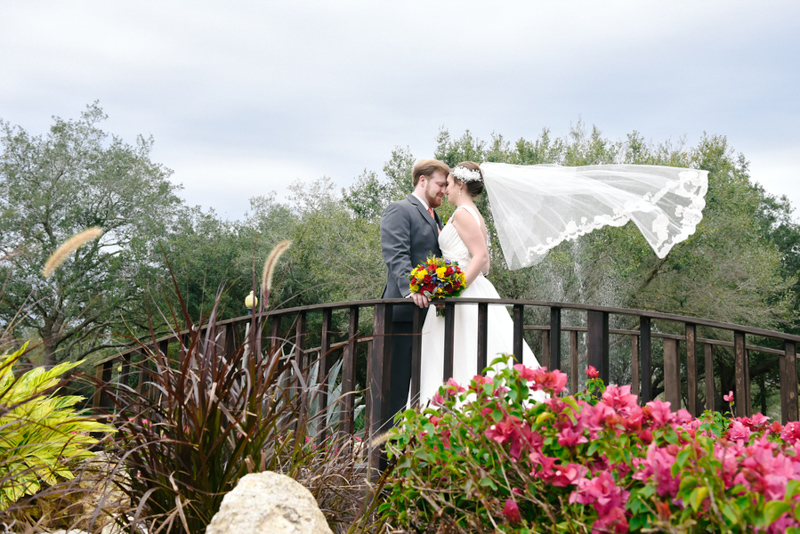 Couple on bridge at Mystic Dunes Resort and Golf Club