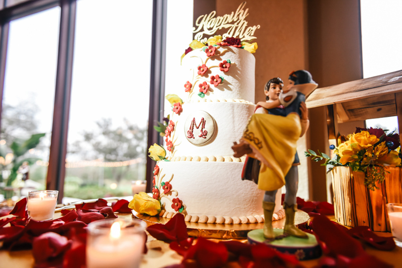 Snow White inspired wedding cake on table