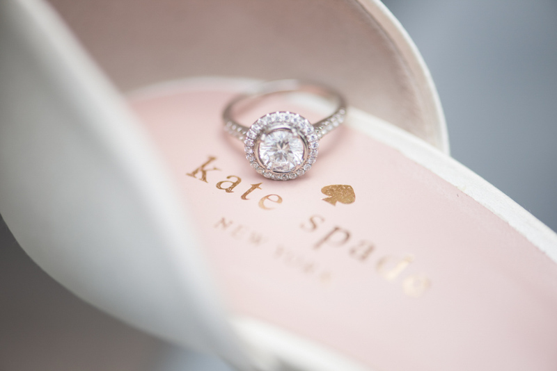 halo engagement ring on Kate Spade shoe